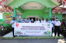 HUT ke 75 RI, KBN Bagikan Bantuan Susu dan Makanan Sehat